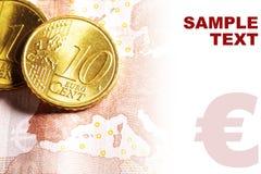 Euro pièces de monnaie de cent sur le billet de banque Images stock