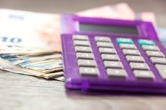 Euro pieniądze i kalkulator zdjęcie royalty free