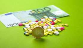 Euro with pills. Pills and tablets with Euro Stock Photos