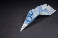 Euro Plane. An origami airplane made with twenty euros Royalty Free Stock Photo