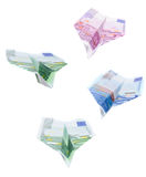 Euro planes. Four paper Euro planes are going down Royalty Free Stock Photo