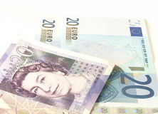 Euro and pound conversion. Euro and pound banknotes on white isolated background stock images