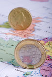 Euro and Pound on Map. Portrait aspect view of a Euro Coin on the European section of a map, and the British pound blurred in the background. Ideal for any work Royalty Free Stock Photo