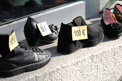 Euro price tags on shoes Royalty Free Stock Photography
