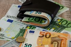 Euro purse with money on wooden background close up royalty free stock photography