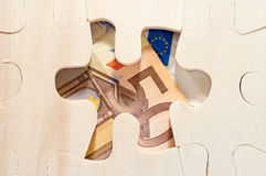 Euro through puzzle Royalty Free Stock Image