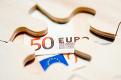 Euro through puzzle Royalty Free Stock Photo