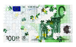 100 Euro puzzle. Photo of a 100 euro on a jigsaw puzzle Royalty Free Stock Photography