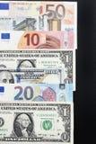 Euro rachunki i dolarowi rachunki Obrazy Stock