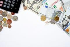 Euro rachunki i dolarowi rachunki z monetą, szkłami i kalkulatorem, Obrazy Royalty Free