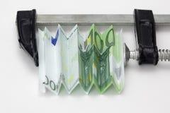 Euro rekening die in een klem wordt gedrukt royalty-vrije stock afbeelding