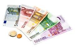 Euro rekeningen en muntstukken Stock Foto's