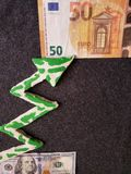 The euro rises in value against american dollar, euro banknote, american dollar bill and ascending arrow in green with white. Backdrop for announcements of royalty free stock images