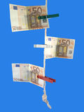 Euro on the rope. Money-laundering Royalty Free Stock Image