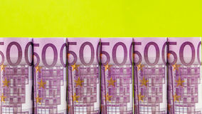 500 euro row on green background Stock Images