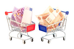Euro and rubles in shopping cart Royalty Free Stock Images
