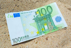 Euro on the sand. Royalty Free Stock Image