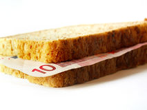 Euro sandwich. Sandwich with two bred slices and 10 euro bill on white background Stock Images