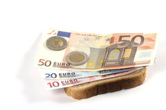 Euro sandwich. Banknotes on a slice of bread Royalty Free Stock Photography