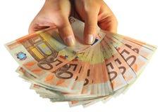 Euro savings. Woman hands holding euro money Stock Photo