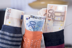 Euro savings hidden in a sock Stock Image