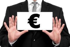 Euro segno. L'uomo d'affari mostra il biglietto da visita Fotografia Stock