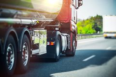 Euro Semi Truck on Highway. Euro Semi Truck on the Highway. Semi Truck Heavy Duty Transportation Stock Photo
