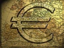Euro sign. A golden 3d euro symbol over a golden map royalty free stock photos