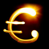 Euro sign. Created by light over black background Royalty Free Stock Image