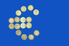 Euro sign on blue Royalty Free Stock Image