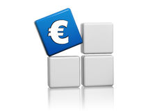 Euro sign in blue cube on grey boxes Stock Photos