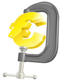 Euro sign in clamp concept Stock Images
