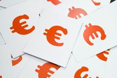 Euro Sign Close Up. Euro money sign in white and red paper Stock Images