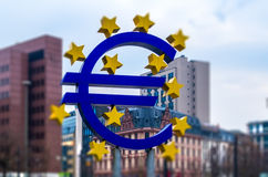 Euro sign at Franfurt. Blurred defocused photo. Blurred pic of euro sign at Frankfurt, Germany Royalty Free Stock Photos