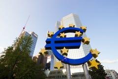 Euro sign and European Central Bank. FRANKFURT, GERMANY - JUL 11: Euro sign outside the European Central Bank on July 11, 2013 in Frankfurt Germany. The ECB is stock image