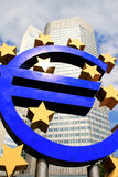 EURO sign in front of a skyscraper Royalty Free Stock Photo