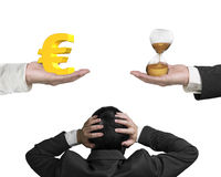 Euro sign and hour glass with businessman hand holding head. Euro sign on one hand and hour glass on another hand, with confused businessman hand holding head stock photography