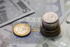 Euro sign made of euro coins. Banknote background. Euro EUR, US dollars USD and other currency. The symbol of the European payment system stock images