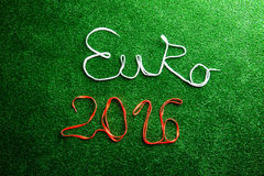 Euro 2016 sign made of shoelaces against artificial turf Stock Photo