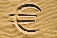 Euro sign in the sand. Euro sign drawn in the sand on the beach Stock Photography