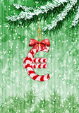Euro sign in shape of candy on christmas tree Royalty Free Stock Images