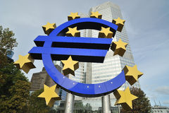 EURO sign with skyscraper in the background Royalty Free Stock Image