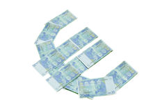 Euro sign symbol made of banknotes greenback paper money. Isolated on white Royalty Free Stock Photography