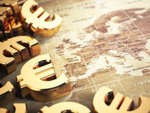 Euro sign on the world map background with DOF effect. 3d Stock Photos