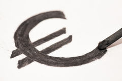 Euro sign. Written with coal isolated over white Royalty Free Stock Image