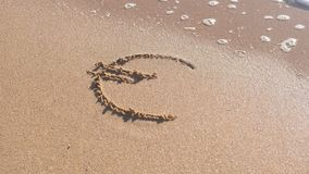Euro sign written in the sea sand. Waves washed away the inscription. Euro sign written in the sea sand. Waves washed away the inscription stock video