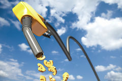 Euro signs dripping out of a yellow fuel nozzle Royalty Free Stock Photos