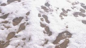 Euro signs written in the sea sand. Waves washed away the inscription. Euro signs written in the sea sand. Waves washed away the inscription stock video footage