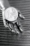 Euro silver coin of futuristic metallic hand Stock Photography