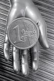 Euro silver coin of futuristic metallic hand Stock Images